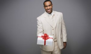 black man with gift